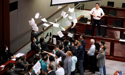 Hong Kong legislature to push ahead with China anthem bill after chaotic scuffles